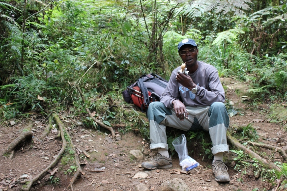 "Kilimanjaro Mountain Guide - Enjoying ""snickers"""
